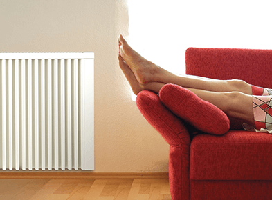 Customer enjoying warmth from a radiator